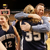 Worcester: Swampscott girl's basketball head coach Jack Hughes celebrates with Caroline Murphy on the court after defeating Quaboag Regional High School to win the State Championship game held at the DCU Center in Worcester Saturday. Photo by Deborah Parker/Salem News Saturday March 14, 2009.