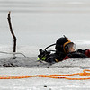 Wenham: Members of the Beverly Fire Department participated in diving training Wednesday afternoon at Wenham Lake. For most, it was a chance to renew their skills and gain valuable experience under the ice. Photo by Deborah Parker/Salem News Wednesday February 25, 2009.