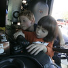 Beverly: From left, best buddies, Brennan Frost, 5, and Chase O'Brien, 4, both of Beverly, examine the front cabin of a fire truck during Beverly Fire Department's open house Saturday.<br /> Photo by Deborah Parker/Salem News Saturday, October 11, 2008