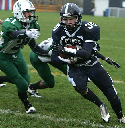 North Shore Tech's Jesse Wilkins avoids the tackle by Manchester Essex's Max Houle during Saturday's game held in Middleton. Photo by Deborah Parker/October 24, 2009