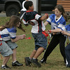 Peabody: Teammates Emma Driscoll, Hope Pare, and Angel Toledo tag an opponent during their flag football game at Emerson Park Saturday. Photo by Deborah Parker/Salem News Saturday, October 25, 2008