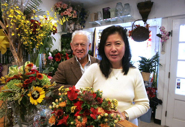 Dave and Jackie Eng of Dave Engs Flowers in Salem, are a husband and wife team, who have been designing floral arrangements for Salem House Tour for 31 years<br />  photo by deborah parker/november 22, 2010