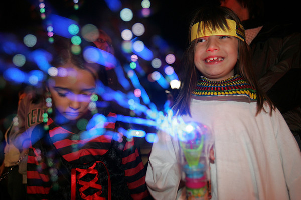 Marissa Fernandes, 6, of Salem blows bubbles at floats passing by during last night's Halloween Parade in down town Salem. Photo by Deborah Parker/October 1, 2009
