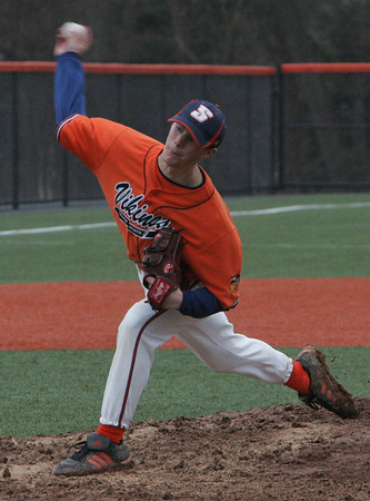 Salem State's Matt Kerr throws out a pitch during yesterday's game against Brandeis held at Salem State College. Photo by Deborah Parker/March 22, 2010