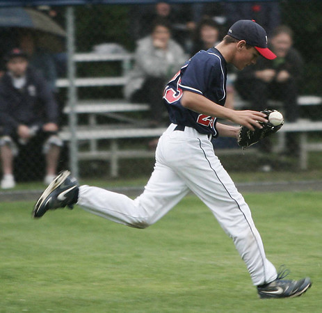 Peabody West's Sean McGrath delicately balances the ball in his glove for the out against Lynnfield during yesterday's Little League sectionals held at Wyoma Field. Photo by Deborah Parker/July 23, 2009