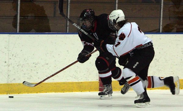 Marblehead's Chris McLeod and Beverly's Andrew Irving fight for control of the puck during last night's game held at Salem State College. Photo by Deborah Parker/January 13, 2009