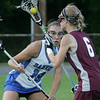 Danvers' Alex Strangie defends against Weston's Julia Meehan during yesterday's Division 2 North state tournament quarterfinal held at Deering Stadium in Danvers Monday evening. Photo by Deborah Parker/June 7, 2010