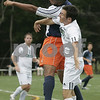 Beverly : Salem State's Tony Moreno and Endicott's Nick Goldman head the ball during yesterday's game held at Endicott College. Photo by Deborah Parker/Salem News Saturday, September 06, 2008