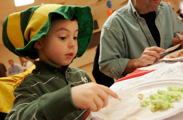 Beverly: Michael Bietrini, 5, of Beverly goes in for another fork full of green eggs while the Italian Community Center Saturday morning. The Kiwanis Club held a breakfast, complete with characters and free books,  to celebrate Dr. Seuss' 105th birthday. Photo by Deborah Parker/Salem News Saturday, March 21, 2009.