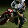 Masconomet's John Daniels is takcled by Triton's Matt Pearson during Friday night's game at Masconomet. Photo by Deborah Parker/October 23, 2009