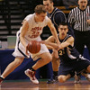 St. John's Stephen Haladyna tries to steal the ball from Central Catholic's Jim Zenevitch during last night's Division 1 Sectional Finals at the Garden Friday evening. Photo by Deborah Parker/March 5, 2010
