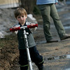 Beverly: Adam Taglieri, 2, of Beverly carefully balances his scooter as he walks down Dane Street his mom Greta, during the warm weather Wednesday afternoon. Photo by Deborah Parker/Salem News Wednesday, February 11, 2009.