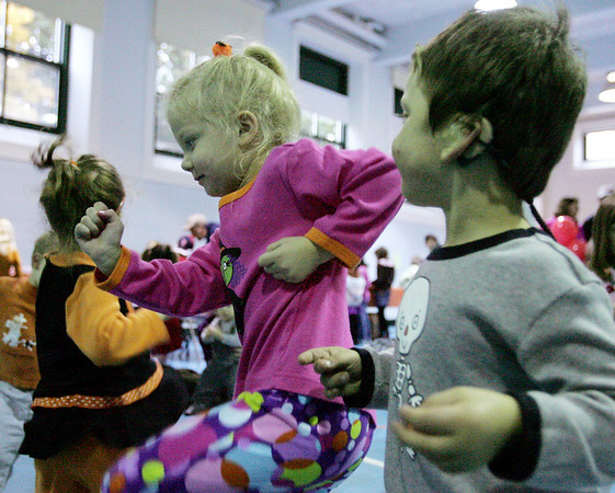 From left, Camille Kamisky, 4, of Middelton and Allison and Brett Kane, both 3, of Danvers dance to the music of Judy Pancoast while attending the 25th Annual Middleton Pumpkin Festival Saturday morning. Photo by Deborah Parker/October 24, 2009
