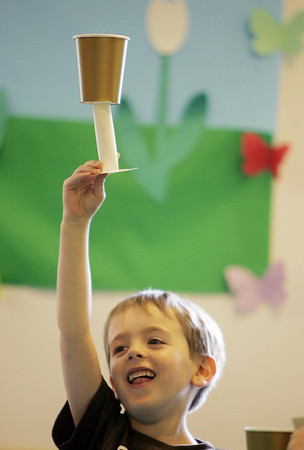 """Timothy Clay, 6, of Marblehead, holds up his own """"holy grail"""" that he created with a paper cup after hearing the medevial story of Perceval and the holy grail. The craft and story was part of Medival in the Morning, a summer program at the Salem Public Library. photo by Deborah Parker/july 20, 2010"""