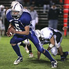 Danvers: Danvers' Colin Cooper runs through Peabody's defense during last night's game at Deering Stadium at Danvers High School.<br /> Photo by Deborah Parker/Salem News Friday, October 03, 2008
