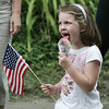Lily Silver, 6, of Wakefield licks a snow cone while watching the parade celebrating the 375th anniversary of Ipswich Sunday afternoon. Photo by Deborah Parker/ August 9, 2009