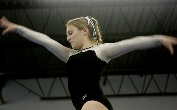 Salem: Bishop Fenwick's Diana Tauro performs on the balance beam during the Crusader Inviational held at Baker's gym Friday night. Photo by Deborah Parker/Salem News Friday, January 30, 2009.