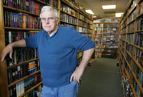 Peter Smyth of Danvers owns Hand-It-Back Booksmyth in Middleton. When he was diagnosed with cancer, people volunteered to work at his shop to keep it open. Today he's back at work. Photo by Deborah Parker/April 13, 2010