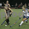 Wenham: Gordon College's Maggie Lafferty and Eastern University's Amanda Maloney race for the ball during last night's Field Hockey Classic game held at Gordon. As of the first half, Gordon was down 0-3. Photo by Deborah Parker/Salem News Friday, August 29, 2008