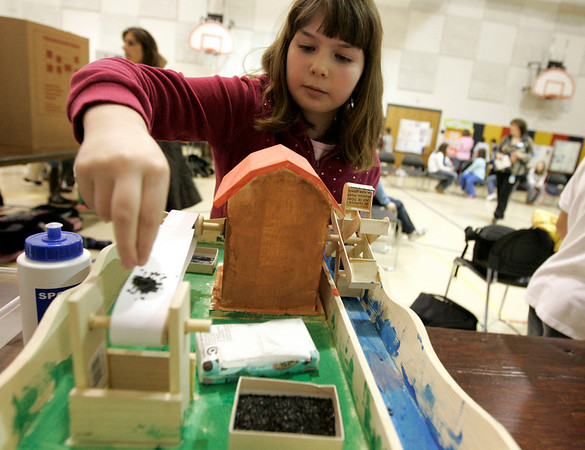 Beverly: Ayers Elementary School student, Abby Murphy, shows how her science fair project about water power works. This is the school's first every science fair and grades third through fourth participated. Photo by Deborah Parker/Salem News Thursday, March 12, 2009.