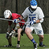 Salem's Troy Gilbert fights for control of the ball with Danvers' Nick Serino during yesterday's game held in Danvers. PHoto by Deborah Parker/April 19, 2010