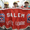 From left, Christopher Nocivelli, Juan Espinal, Miles Kelleher and Jacob Wallinga, lead the Annual Salem Little League Parade Sunday morning. Starting at Salem State College, the parade crossed Lafayette Street and ended at Forest River Park. Photo by Deborah Parker/April 25, 2010