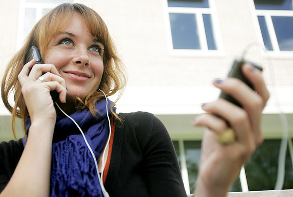 Gordon College senior Meg Lynch illustrates how students can multi task while listening to music and texting. Photo by Deborah Parker/October 2, 2009