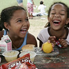 Nadia Castallanos, left, and Jahmela Dyce, both six and of Salem giggle while eating their lunch at  YMCA Explorer camp held at Plummer Home for Boys. The camp is one of the recepients of the Salem summer food program, run through the schools, which provides free lunches to more than 600 kids around the city daily. Photo by Deborah Parker/August 20, 2009