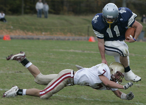 Hamilton:**(There was no roster)** Hamilton's Stephen Dangora escapes the tackled by Newburyport's #7 during yesterday's game at Hamilton. Newburyport defeated Hamilton 28-14.<br /> Photo by Deborah Parker/Salem News Saturday, October 25, 2008