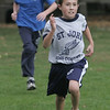 Jack Keenan, a fifth grade student at St. John's of Peabody, runs to the finish line to beat Matt O'Donnell of St. Mary's of Melrose during their cross country meet held at Emerson Park in Peabody Thursday afternoon. Photo by deborah parker/october 14, 2010