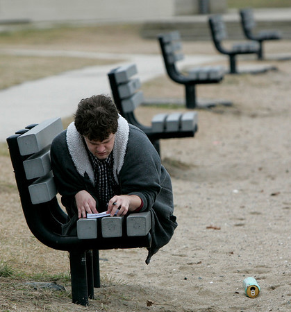 Beverly: Steve Hardy of Beverly took advantage of the warm weather Sunday to sit outside at Dane Street Beach to write. Photo by Deborah Parker/Salem News Sunday, December 28, 2008.