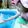 Mary Demsey, 2, of Salem floats a boat she created at a kids station during the Antique and Classic Boat Festival held at Hawthorne Cove Saturday. Photo by Deborah Parker/August 22, 2009