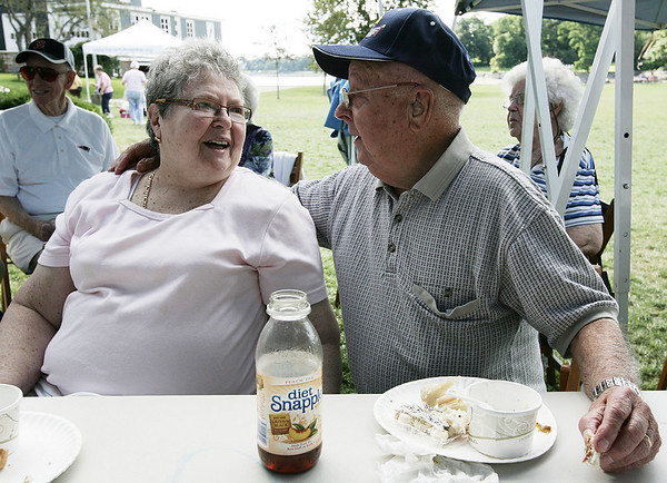 Ed and Louise Keenan of Beverly chat together while enjoying the Veterans Cookout at Lynch Park Friday afternoon, as part of Beverly Homecoming. Photo by Deborah Parker/August 7, 2009