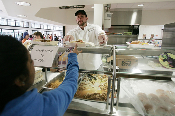 Professional Chef Kirk Conrad hands out a chicken fajita lunch for students on Thursday at the Salem High School cafeteria. Conrad has been working with the school this year to develop healthier and more appealing menus. Photo by deborah parker/october 28, 2010