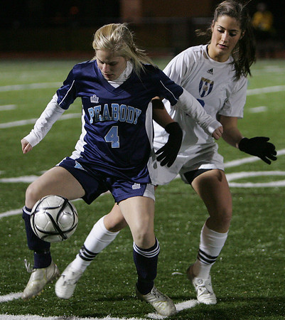 Peabody's Amanda Nihan keeps the ball from Acton-Boxboro Kristina DeLeo in Division 1 North soccer final held at Fraser Field in Lynn Monday evening. Photo by Deborah Parker/November 16, 2009