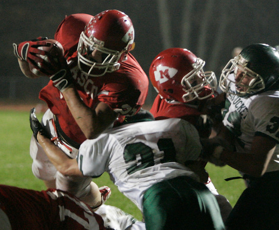 Boxford: Masconomet's Evan Bunker jumpes over  Pentucket's defensive line near the endzone during last night's game held at Masco. Photo by Deborah Parker/Salem News Friday, November 7, 2008.