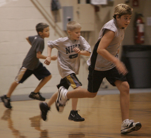 Mark Cavallaro of Middleton works through a running drill during a youth basketball clinic at the Shore County Day School in Beverly Monday evening. Photo by Deborah Parker/October 4, 2010