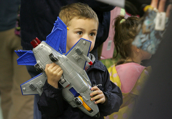 Axel Hardy, 5, of Quincy plays with a toy plane his parents bought for him while at the Toy Fair held at the Topsfiled Fair grounds Saturday morning. Photo by Deborah Parker/November 14, 2009