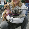 Crystal Caissie of Salem poses with her two dogs, Miley and Mia, during the Northeast Animal Shelter's Blessing of the Animals event Saturday. Photo by Deborah Parker/October 10, 2009