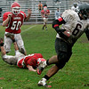 Saugus: Marblehead's Sam Perlow escapes the tackle and runs the ball down the field during Saturday's game held in Saugus. Photo by Deborah Parker/Salem News Saturday, November 15, 2008.