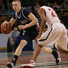 St. John's Conor Macomber is defended by Central Catholic's Luis Puello during last night's Division 1 Sectional Finals at the Garden Friday evening. Photo by Deborah Parker/March 5, 2010