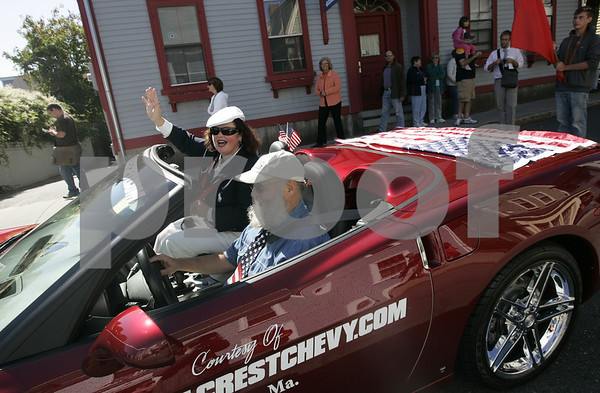 Marblehead: Para olympic sailing gold medal winner, Maureen McKinnon-Tucker waves to the crowd while traveling down State Street Saturday as part of a parade in her honor. Starting at the Old Town House, Tucker was driven in a red corvette through the streets of downtown ending with a ceremony at Fort Sewall.<br /> Photo by Deborah Parker/Salem News Saturday, September 20, 2008