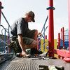 Paul Brean of Beverly works to install a platform on a newly constructed playground located behind North Beverly Elementary School. This weekend volunteers including Mayor Scanlon and the company providing the equipment, UltiPlay, came together to put the playground together. Photographer Deborah Parker/August 22, 2009