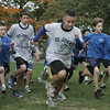 Students from St. John's of Peabody and St. Mary's of Melrose move from the startig line of the cross country meet held at Emerson Park in Peabody Thursday afternoon. Photo by deborah parker/october 14, 2010