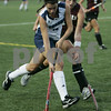 Wenham: Gordon College's Abigail Walker maintains control of the ball over Eastern University's Leslie Messick during last night's Field Hockey Classic game held at Gordon. As of the first half, Gordon was down 0-3. Photo by Deborah Parker/Salem News Friday, August 29, 2008