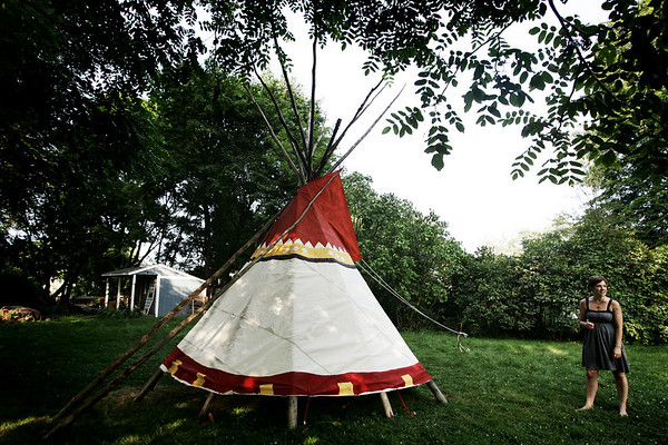 Sarah Johnson is an artist who has built a teepee in her friend's backyard as an art project. She plans to live in the teepee starting on Saturday. PHoto by Deborah Parker/July 30, 2009