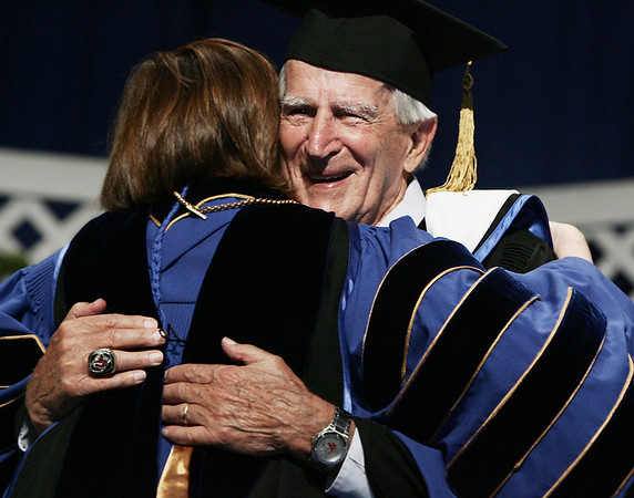 Salem: Red Sox legend Johnny Pesky receives a hug from Salem State President Patricia Maguire Meservey after being awarded a Doctor of Humane Letters Honorary Degree during the Salem State Graduation ceremony Saturday. (No name on presentor, not in program). Photo by Deborah Parker/May 16, 2009