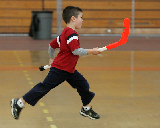 Joe Brown, 5, of Beverly skips down the court after his team scored a goal while playing a game of indoor hockey at Beverly High School Tuesday morning. The Beverly High School class of 2010 hosted a Elementary Fun Day at the high school which included crafts, sports, games, and a visit by the Beverly Panther. Photo by Deborah Parker/Novemeber 3, 2009