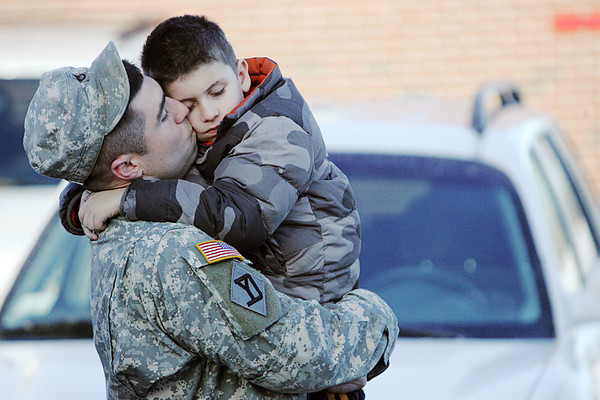 Staff Sergeant MIke Covel embraces his son, Shamus, 6, before boarding a bus to join the Massachusetts National Guard 101st Field Artillery Unit, based at the Danvers Armory, as they deployed today for training as they head to Afghanistan. Photo by Deborah Parker/January 6, 2009.
