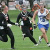Danvers' Rebecca Cann is defended by Beverly's Allie Donnelly and Carly Baker during yesterday's game held at Danvers High School. Photo by Deborah Parker/April 27, 2010
